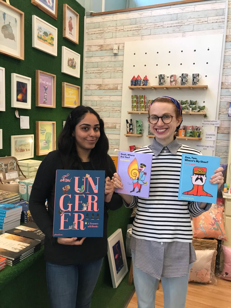 Booksellers Garima and Elizabeth with some of their favourite Tomi Ungerer books in Tales for Tadpoles in Dublin, Ireland.
