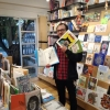 Bookseller Santiago shows off more of Tomi's books in Babel Libros, Colombia.