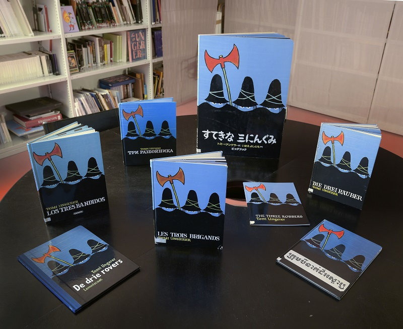 Multiple language editions of The Three Robbers in Musée Tomi Ungerer in Strasbourg. The museum is dedicated to Tomi's work and to celebrating illustrated arts. Photo by Mathieu Bertola.