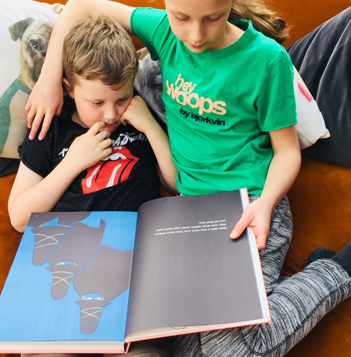 Sarah Yewman AKA Picture Books Blogger shared this picture of her children enjoying a favourite, The Three Robbers.