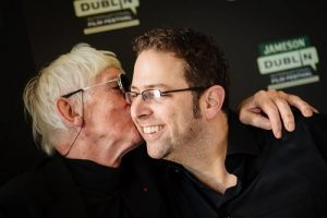 Tomi Ungerer kisses director Brad Bernstein at a screening of Far Out Isn't Far Enough